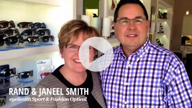 Picture of a middle-aged white married couple standing in their optometry shop.